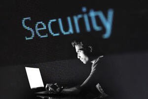 Canva - Man Researching On Laptop With Security Sign